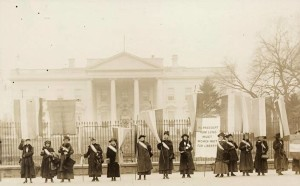 Women suffragists stand their ground in front of the White House in 1917.