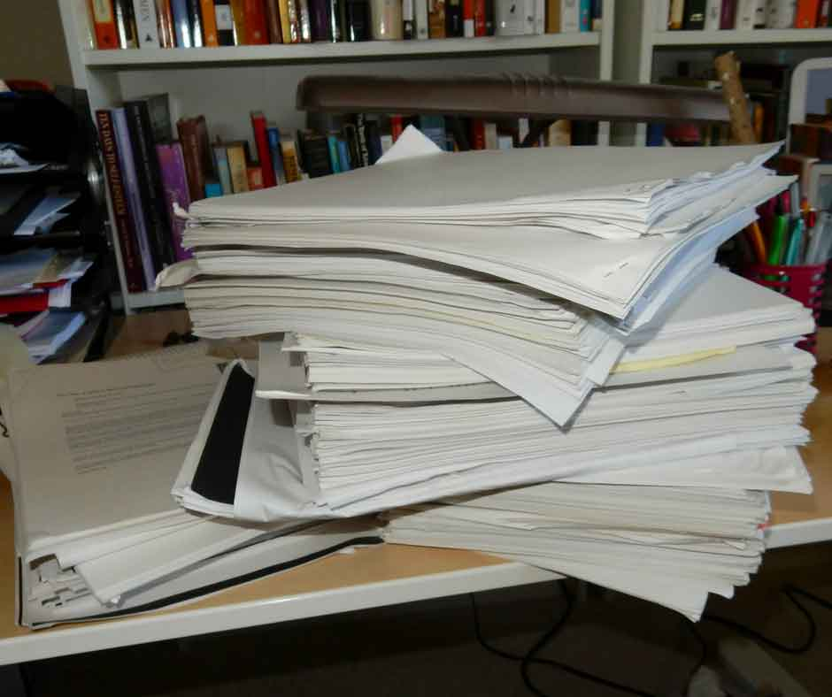 Stack of research papers, notebooks, and first drafts in the studio of Kathleen Colvin