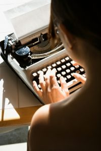 Photograph of a woman writer typing