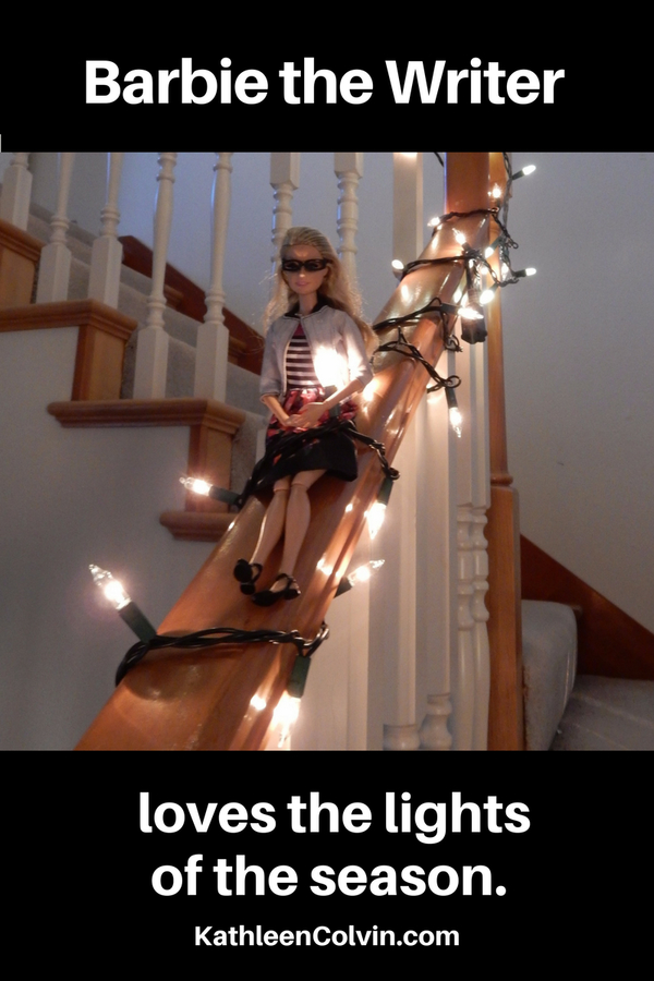 Barbie the Writer on the stairs with holiday lights
