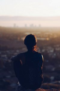 A photo of a woman looking towards the light