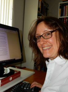 Photo of Kathleen Colvin at her computer